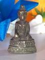 พระกริ่ง ปางทรงพิจารณาชราธรรม ทำเป็นพระพุทธรูปนั่ง พระหัตถ์ซ้ายขวาจับพระชานุ(เข่า) ทั้งสองข้าง